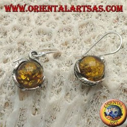 Silver earrings with natural amber sphere between the leaves
