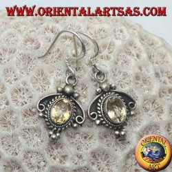 Silver earrings with oval natural yellow topaz on an ethnic setting