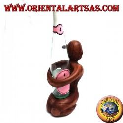 Bottle holder sculpture of a kneeling woman embracing in Suar wood