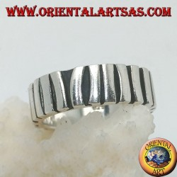Silver band ring with a row of sticks placed parallel