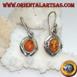 Silver earrings with oval natural amber surrounded by a disc with a ball on the cardinal points