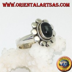 Silver flower ring with oval cabochon black star surrounded by plaiting and diskettes