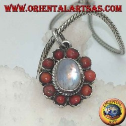 Silver flower pendant with rainbow moonstone cabochon and tibetan coral with petals