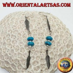 Silver pendant earrings with turquoise discs and balls between two feathers