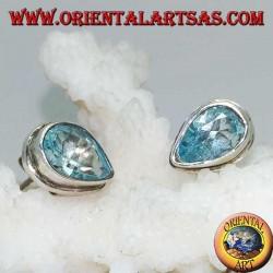 Silver lobe earrings with blue drop topaz on a simple silver setting