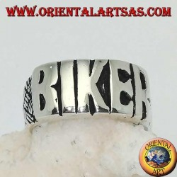 """Silver ring with """"BIKER"""" written in block letters and engravings on the sides"""