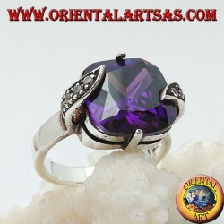 Silver ring with amethyst-colored square zircon set between marcasite leaves