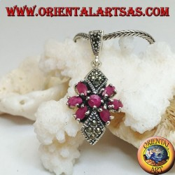 Silver pendant with a round ruby in a star of natural oval rubies and two marcasite rhombuses