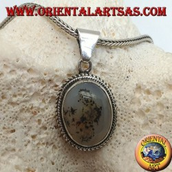 Silver pendant with oval cabochon musk agate surrounded by subtle weave