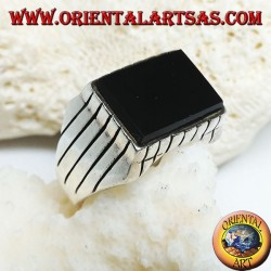 Silver ring with raised rectangular flat onyx and stripes on the sides