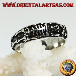 Silver record ring with integral high relief skeleton
