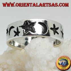 Smooth silver ring with thick engravings of stars and moons