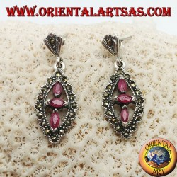 Silver earrings with three natural oval rubies in a marcasite rhombus