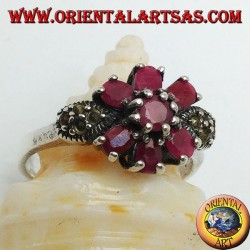 Silver ring with natural round ruby set with three rubies above and below and marcasite on the sides