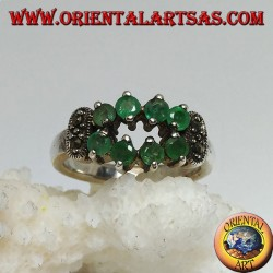 Shuttle silver ring punched with natural round emeralds set and marked on the sides