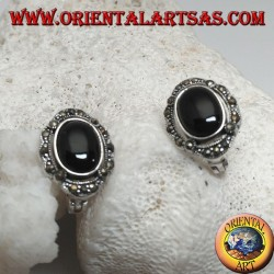 Silver lobe earrings with oval onyx surrounded by marcasite and lever closure