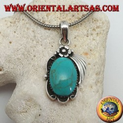 Silver pendant with large oval turquoise on a frame with flower and ribbon