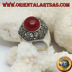 Silver ring with round cabochon carnelian on a decorated perforated hexagon studded with marcasite