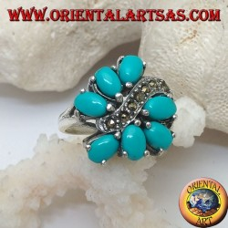 Silver ring with 7 oval turquoise set, divided by a marcasite wave line