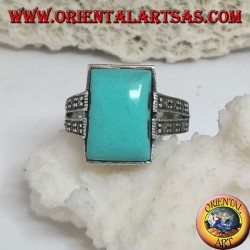 Silver ring with rectangular turquoise in a ball frame and two rows of marcasite on the sides
