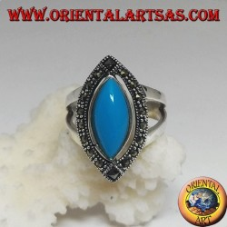 Silver ring, with turquoise cabochon cut shuttle surrounded by marcasite