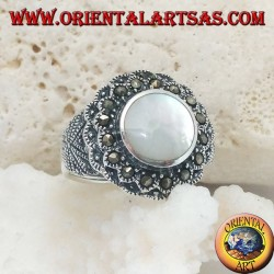 Silver ring with raised mother of pearl surrounded by marcasite