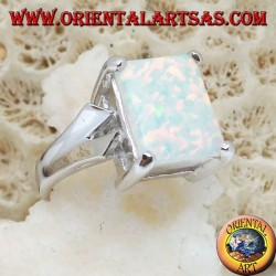 Silver ring with rectangular white opal set and V-shaped frame on the sides