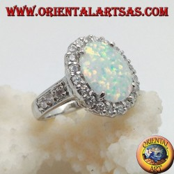 Silver ring with oval harlequin opal set with zircons around and on the sides