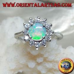 Anello in argento con opale arlecchino tondo incastonato a quattro contornato da zirconi