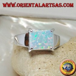 Silver ring with horizontal rectangular harlequin opal set in four