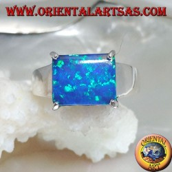 Silver ring with horizontal rectangular blue opal set in four