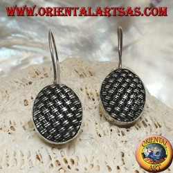 Dangling silver earrings with tightly woven oval