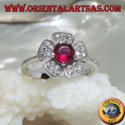 Silver ring in the shape of a wild strawberry flower with a garnet corolla set and zircon petals