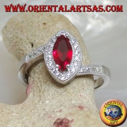 Silver ring with shuttle garnet set surrounded by zircons and asymmetrical setting