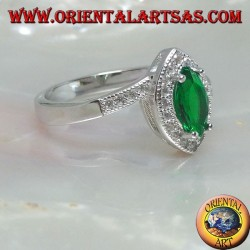 Silver ring with synthetic shuttle emerald set surrounded by zircons on an asymmetrical setting