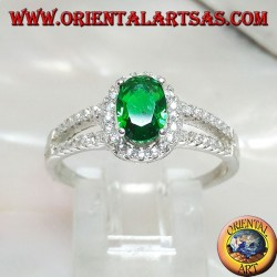 Silver ring with oval synthetic emerald set surrounded by zircons and two lateral lines