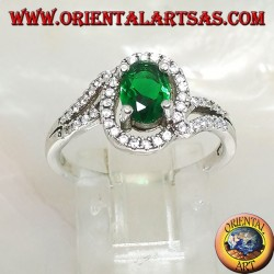 Silver ring with oval synthetic emerald set surrounded by zircons on a concentric setting