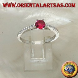 Silver ring with round synthetic ruby set on a thin row of cubic zirconia setting