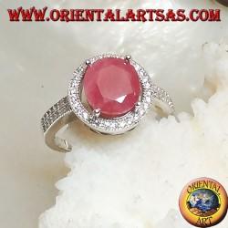 Серебряное кольцо с овальным натуральным рубином на круглой рамке с цирконами