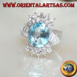 Серебряное кольцо с набором из натурального голубого топаза и фианитами сверху, снизу и под углом