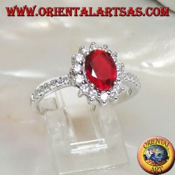 Silver ring with oval garnet set surrounded by zircons and row on the sides