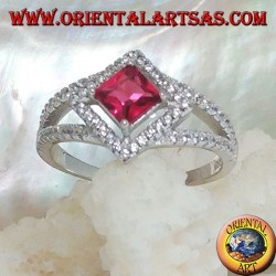 Silver ring with square synthetic ruby set on a rhombus setting with zircons