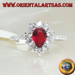 Silver ring with drop garnet set surrounded by cubic zirconia and row on the sides