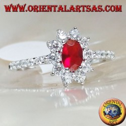 Silver ring with small oval garnet set surrounded by cubic zirconia and row on the sides