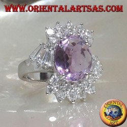 Silver ring with oval natural amethyst set and zircons above, below and at an angle
