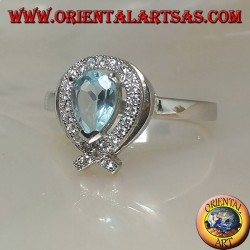Silver ring with natural blue drop topaz surrounded by zircons (intersection on tip)