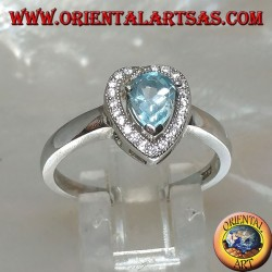 Silver ring with natural blue drop topaz set surrounded by zircons