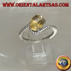 Silver ring with transverse oval natural yellow topaz on an asymmetrical setting with zircons