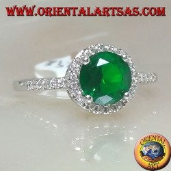 Silver ring with round synthetic emerald set surrounded by zircons