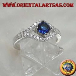 Silver ring in the shape of an eye with a set round synthetic sapphire and contour zircons